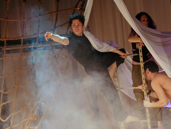 Salem:  Jesse Mangan, left, as Odysseus, emerges from a cloud of smoke.  photo by Mark Teiwes / Salem News