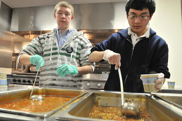 Danvers: St. John's Prep sophomores Max Shinnick, left and Phil Pham serve up lentil and minestrone soup at Empty Bowls Dinner Party with soup donated by local restaurants.  All proceeds benefit Haven From Hunger.  photo by Mark Teiwes  / Salem News