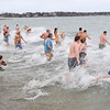 Beverly: At the stroke of noon on Sunday, a crowd ran and dove into the ocean for the Anchor Pub & Grill's Anchor Dip benefiting Hospice of the North Shore and Greater Boston. photo by Mark Teiwes / Salem News