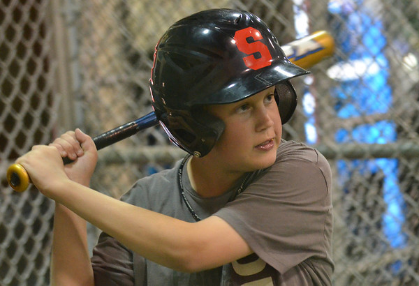 Salem American Little League all-star player Jack Crawley takes aim during batting practice.  photo by Mark Teiwes / Salem News