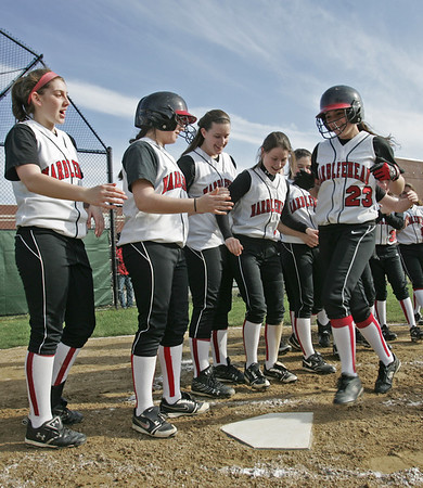 Marblehead: Marblehead's Olivia Vener comes home after hitting a homerun in the team's 5-1 win over Winthrop.   photo by Mark Teiwes / Salem News