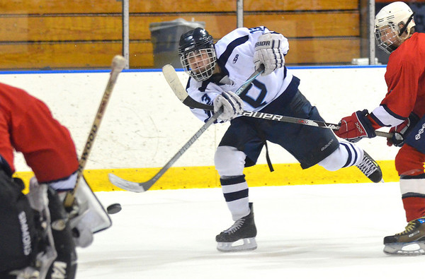 Salem: Peabody's Rob Houghton puts a shot on goal.  He scored the team's first goal in a 3-2 win over Lynn at the Salem State high school hockey jamboree.  photo by Mark Teiwes / Salem News