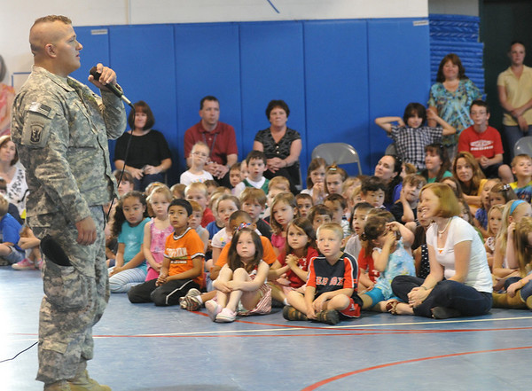 Danvers: Nathan Davis, left, introduces himself at Great Oak School where his fifth grade sister Rachel Davis attends. He is on a two week leave from serving in Afghanistan with the 101st Field Artillery. photo by Mark Teiwes / Salem News