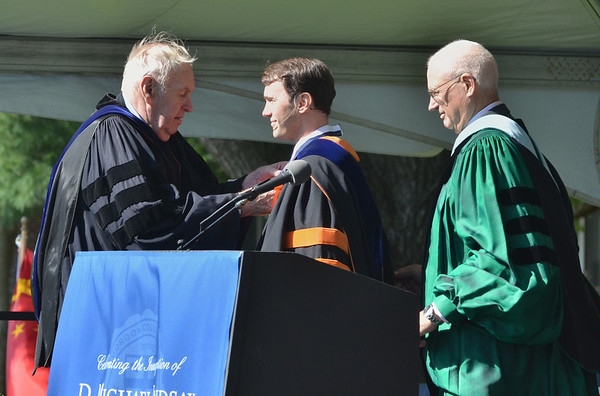 Wenham: Former Gordon College presidents Dr. Richard F. Gross, left, and Dr. R. Judson Carlberg, right, present Dr. D. Michael Lindsay with a presidential medallion during his inauguration ceremony as the new president of Gordon College.  photo by Mark Teiwes / Salem News