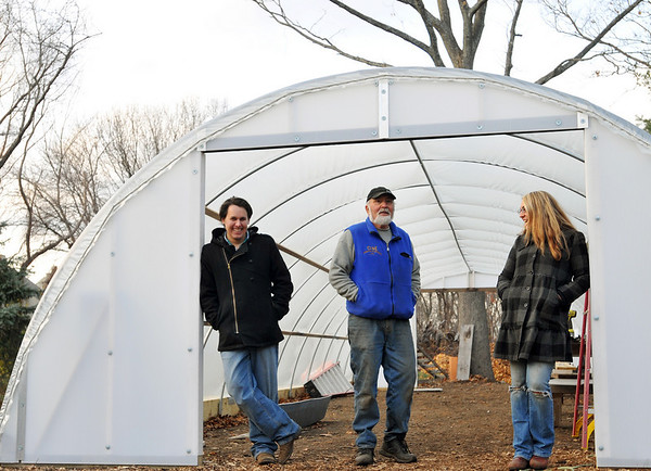 Hamilton: Andy Varela, left, Peter and Holly Maitland of  Maitland Mountain Farms stand in the doorway of a newly constructed greenhouse which will extend the growing season allowing them to sell local produce to the area almost year round.  photo by Mark Teiwes / Salem News
