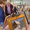 Middleton:  Martha Fucarile, left, and Joan Smart browse the work displayed at the Middleton Arts Association's annual art fair.    photo by Mark Teiwes / Salem News
