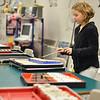 "Salem: Fifth grader Olivia Leger played the song ""Hot Cross Buns"" on metallophones, xylophones, and marimbas in Mrs. Anderson music classroom for the Collins Middle School open house.  photo by Mark Teiwes / Salem News"
