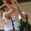 Salem: Salem State guard Lisa Aylward, left, looks to the hoop guarded by Plymouth State's Amanda Kania.  photo by Mark Teiwes / Salem News
