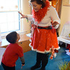 Marblehead:  Marguerite Frank, right, dresses as an elf for her business.  She talks with Theo Karlin of Swampscott, 3. photo by Mark Teiwes /  Salem News