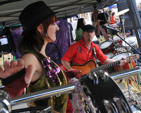Topsfield: Samantha Stephenson, left, and Scott Helland of the Gypsy Nomads performed for the Eastern Mass Pagan Pride Day.  photo by Mark Teiwes / Salem News