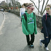 Beverly: Amanda Rosenberger, 12, left, and Brigid Waldron, 11, both both from Beverly Farms stroll along the coast on the 11 mile Good Friday Walk.  The 32nd annual event raises money for organizations who assist people in need.    photo by Mark Teiwes / Salem News