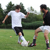 Marblehead:  Marblehead boys soccer team captain Nate Cullen, left, takes on head coach Darren Benedick during practice.  photo by Mark Teiwes / Salem News