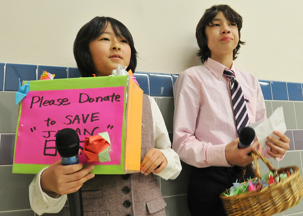 Beverly:  Kai Marcos, left, and Kai Marcos, North Beverly Elementary School fifth graders, were both part of the drama at the school.  During intermission they requested donations for relief efforts in Japan.  photo by Mark Teiwes / Salem News