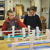 Salem: Fifth grader Ben Jerzylo, left, and sixth grader Kevin Oshea look at a cable-stayed bridge made in technology education class displayed for Collins Middle School open house.  photo by Mark Teiwes / Salem News