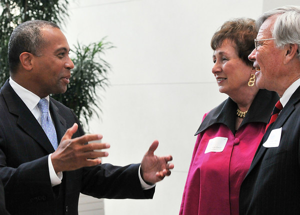 Salem: George Atkins, right, president of the Salem Partnership and Patricia Zaido, executive director of the Salem Partnership welcome Governor Deval Patrick to the Peabody Essex Museum as the guest speaker for the organizations annual dinner.  photo by Mark Teiwes / Salem News