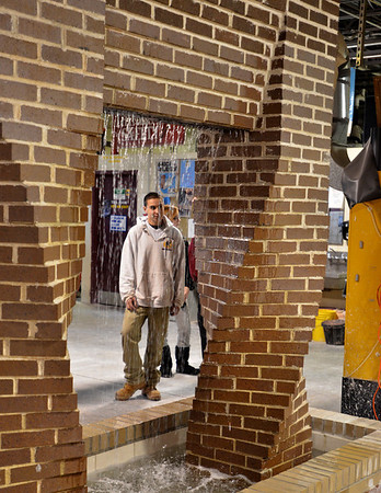 Middleton: David Picillo of Danvers stands behind a waterfall he helped to construct in the masonry program at North Shore Technical High School.  The hands on learning has kept his interest in the subject.  photo by Mark Teiwes / Salem News