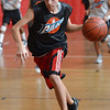 Peabody: Jimmy DiGiulio, 14, takes off on a fast break during the Peabody Basketball Association playoffs at Higgins Middle School.  photo by Mark Teiwes / Salem News
