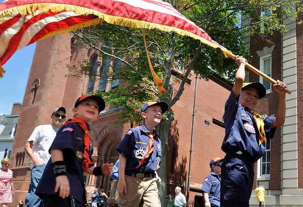 Beverly: Boy Scout Kyle Gallucci, right, carries a flag followed by Colin Andrew, middle, and Alec Donovan, left,  during a parade celebrating Memorial Day.