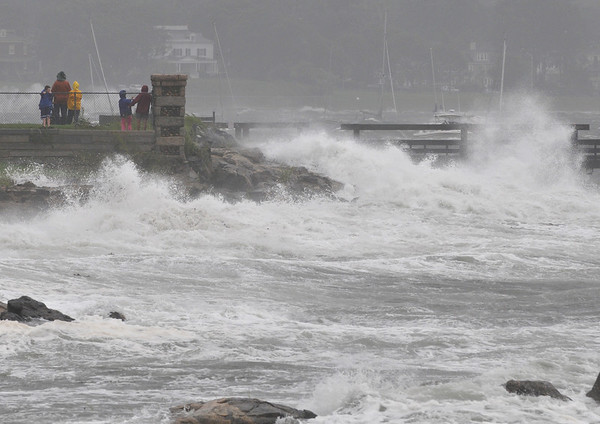 Salem:  A group watches as the storm hits the Willows neighborhood at high tide.   photo by Mark Teiwes / Salem News