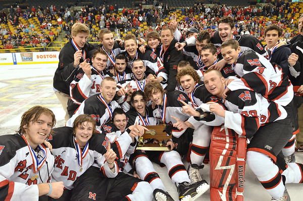 Boston: Marblehead High School boys hockey team celebrate their win in the Division 3 state championship game. photo by Mark Teiwes / Salem News