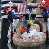 Edwards Adams Brown sleeps in a decorated stoller at the Memorial Parade in Danvers.