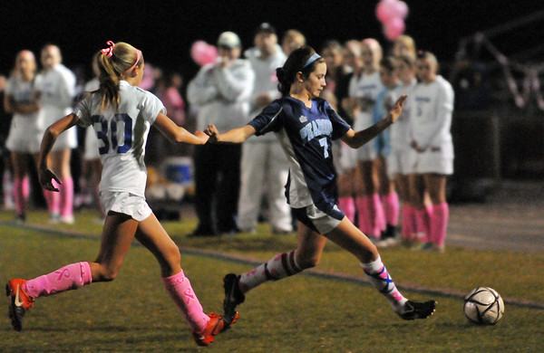 Danvers: Peabody's Angela Ellison, right, looks for a pass on the sideline as Danvers midfielder Delaney Zecha puts on pressure.   photo by Mark Teiwes / Salem News