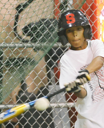 Salem American Little League all-star player Aljenis Vlaun takes a swing at batting practice.  photo by Mark Teiwes / Salem News