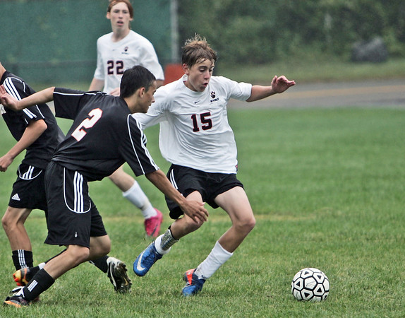 Beverly: Beverly High School's Dylan Perry controls the ball followed by Ipswich's Joe Baraiolo.  photo by Mark Teiwes / Salem News