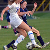 Danvers: Danvers player Kristin Yost, left,  battles with Peabody's Caroline Marie Colbert.  photo by Mark Teiwes / Salem News