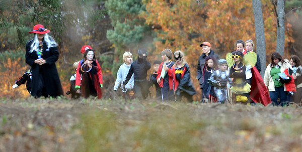 Topsfield: Costumed children are lead through the woods during a Halloween tour of the Audubon.