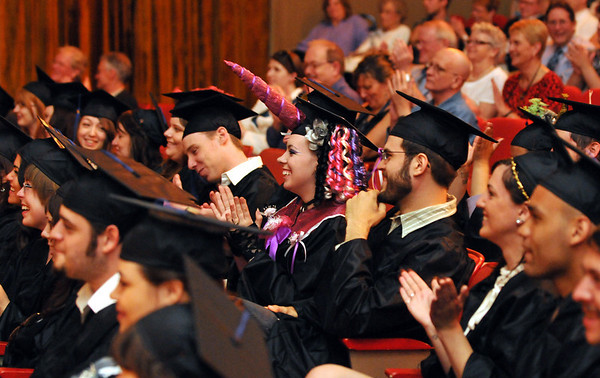 Beverly: Many Montserrat College of Art students decorated their caps and gowns to celebrate graduation including Erica Paszkowski, center, with a pink unicorn horn. staff photo by Mark Teiwes / Salem News