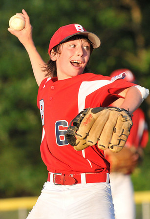 Peabody:  Boxford pitcher winds up for a fastball.    photo by Mark Teiwes / Salem News