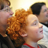 Wenham: Sam Craveiro, 5, and his mom Loretta of Beverly watch an educational magic and song show at the Wenham Museum.   photo by Mark Teiwes  / Salem News