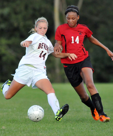 Beverly: Beverly's Eva Gourdeau, left, winds up for a shot covered by Salem's Alex Bryant. photo by Mark Teiwes  / Salem News