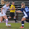 Danvers: Danvers player Corey Persson, left, takes on Peabody defender Bianca Muscato.  photo by Mark Teiwes / Salem News