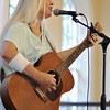 Salem: Julie Dougherty plays out acoustic folk starting off the music for the night.  photo by Mark Teiwes / Salem News