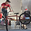 Salem: Ricky Brandano displays a BMX trick at his store on Pickering Wharf.  He also loves to ride at the skate park in Peabody. photo by Mark Teiwes  / Salem News