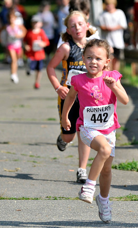 "Salem:  April Weeks smiles as she comes down the final stretch to the finish line during Saturday's ""Wicked Kidz Run"" hosted Wicked Running Club and the Park, Recreation & Community Services Dept.  Mark Teiwes / Salem News"