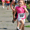 """Salem:  April Weeks smiles as she comes down the final stretch to the finish line during Saturday's """"Wicked Kidz Run"""" hosted Wicked Running Club and the Park, Recreation & Community Services Dept.  Mark Teiwes / Salem News"""