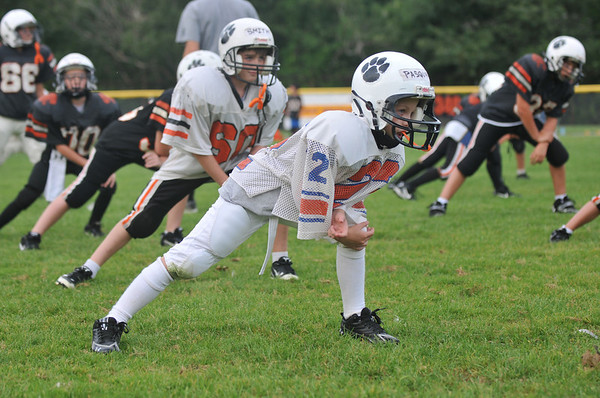 Beverly:  Anthony Pasquarosa, 9, warms up with his Crusader Black team at the start of practice. photo by Mark Teiwes /  Salem News