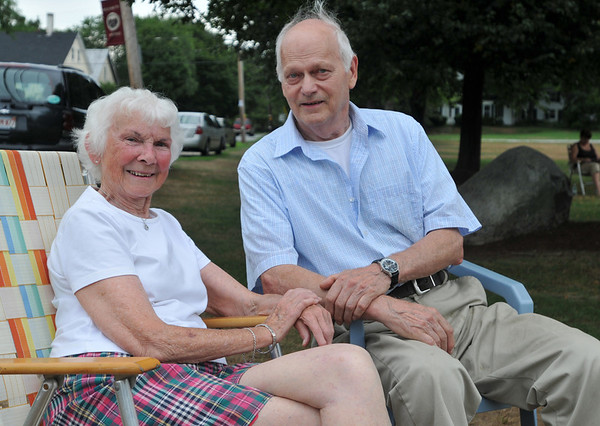 Topsfield: Jackie Scudder, left, and Paul Jackman enjoy music and good company at the Topsfield Common.  photo by Mark Teiwes / Salem News