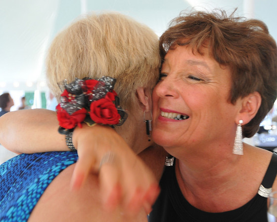 Danvers: Kathy Bishop, the 2010 winner of the Danvers Family Festival Baron Mayer Award,  gets a hug from a friend during the gala.  photo by Mark Teiwes / Salem News