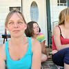 Salem: Deedee Kinsella sits in front of her daughters Cassandra, and Catherine, right.  They live near a proposed methadone clinic.  Deedee Kinsella is one of several neighbors fighting the project.   photo by Mark Teiwes / Salem News