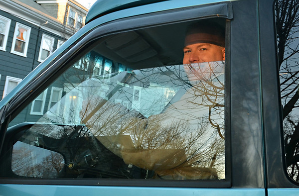 Salem:  Bruce Mabbott sits in the drivers seat of a wheelchair lift-equipped Chevy Astro Van he will donate when he arrives in Mongolia.  His last big adventure was in 2009 on a 3000 mile cycle trip across the country.  photo by Mark Teiwes / Salem News