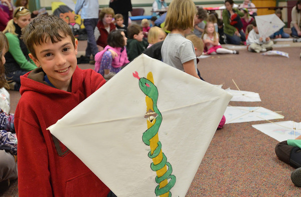 Hamilton: Nathan Giarnese, 11, of Hamilton, drew a rod of Asclepius on a kite he built during a workshop at the Hamilton-Wenham Public Library. photo by Mark Teiwes / Salem News