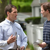 Beverly: Mayoral candidate Mike Cahill, left, campaigns along Foster Street speaking with Mike Kwapniewski.  photo by Mark Teiwes / Salem News
