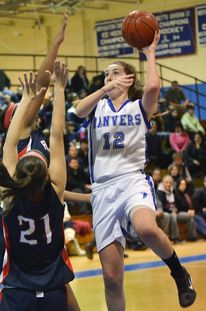 Danvers: Danvers captain Kellie Macdonald makes a hook shot over the Revere defense.   photo by Mark Teiwes  / Salem News