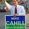 Beverly: Mayoral candidate Mike Cahill waves to passersby along Sohier Road before last night's debate at Beverly High School.  photo by Mark Teiwes / Salem News