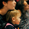 Salem: Sydney Rhodes and her 1-year-old sister Violet White watch a concert performance by South African singing group Thula Sizwe at Saltonstall School.    photo by Mark Teiwes / Salem News