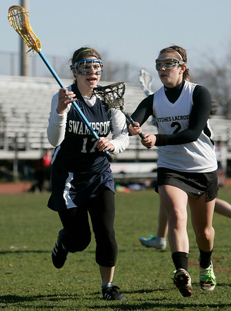 Salem: Swampscott's Maggie Osbahr, left, carries the ball to the goal followed by Salem denfender LaurenSchaejbe.  photo by Mark Teiwes / Salem News